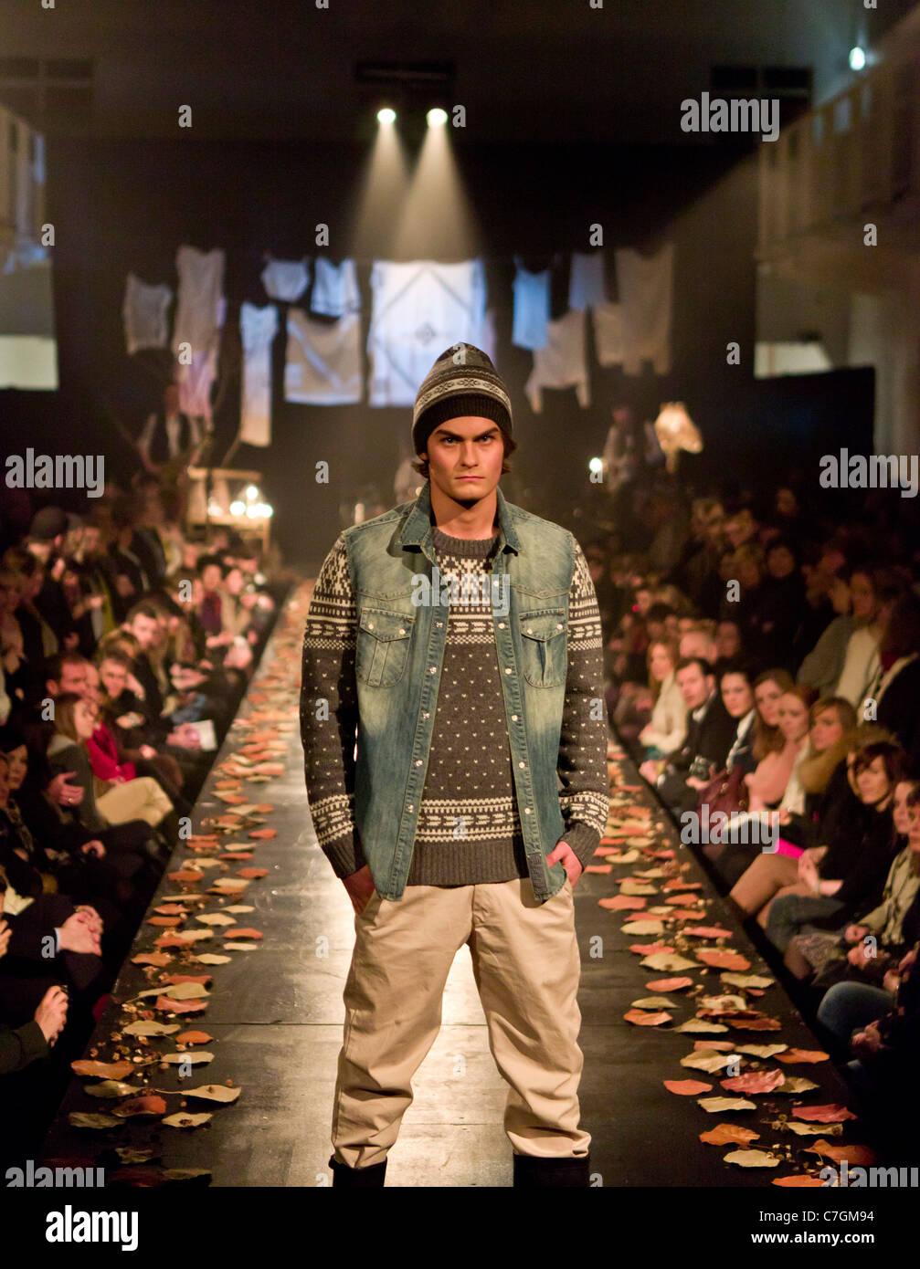 Male model on catwalk at fashion show, Reykjavik Iceland - Stock Image