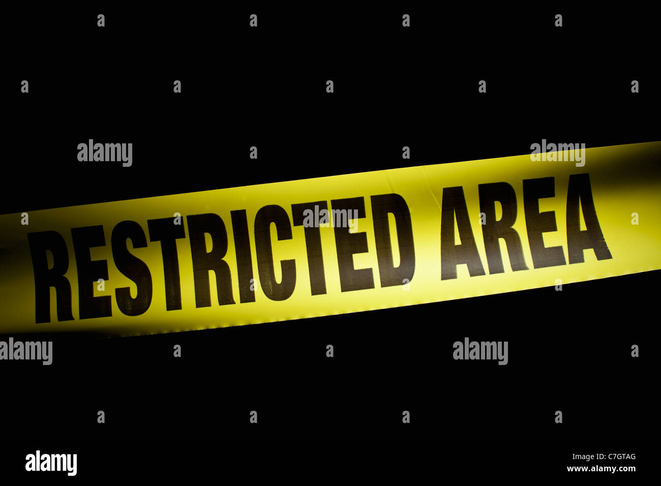 Detail of RESTRICTED AREA cordon tape - Stock Image