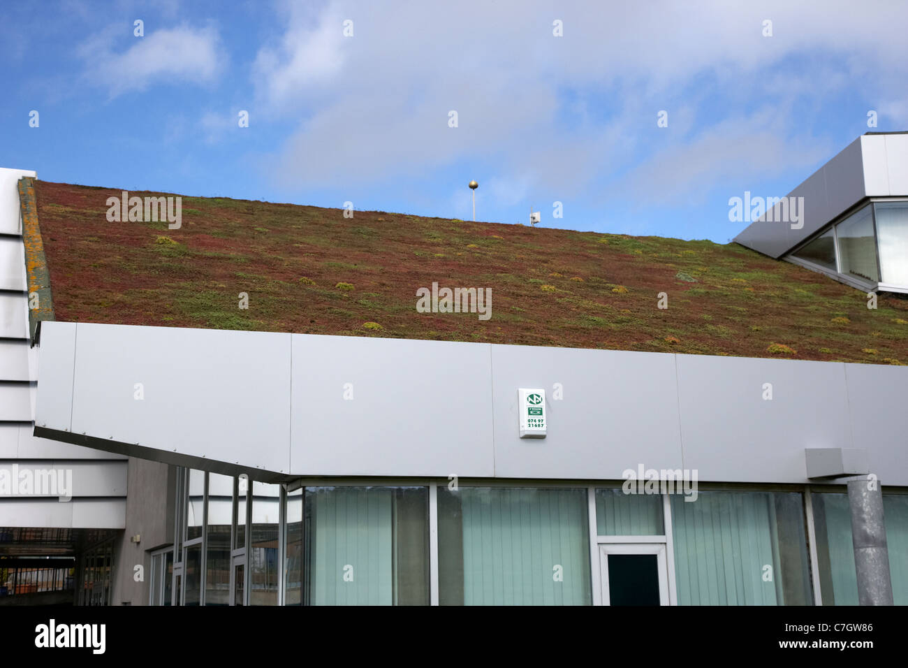 sloping sedum grass roof on a public services building in letterkenny county donegal republic of ireland - Stock Image