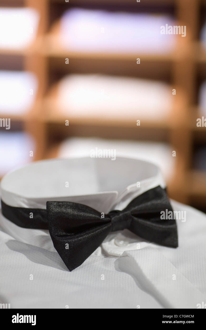 A tuxedo shirt and bow tie, close-up of bow tie, in a menswear store Stock Photo