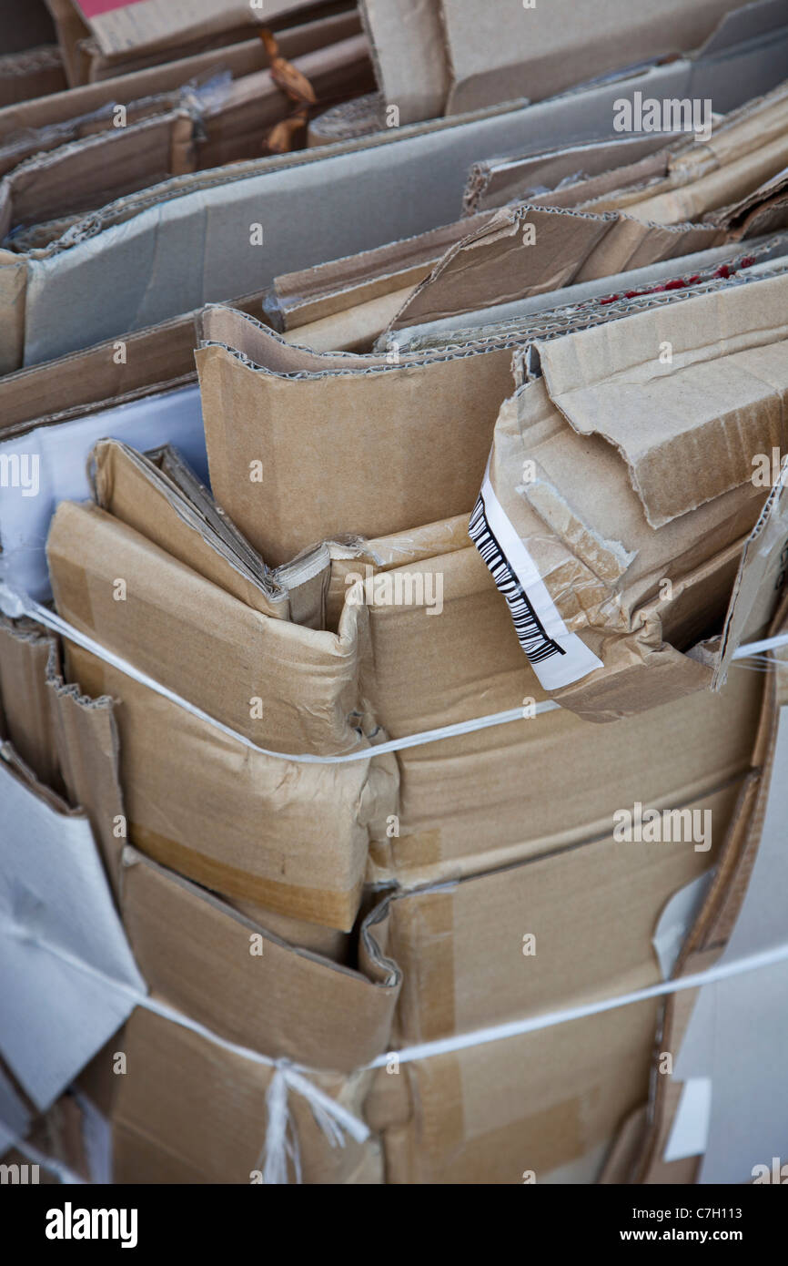Flattened cardboard boxes tied with twine and ready to be