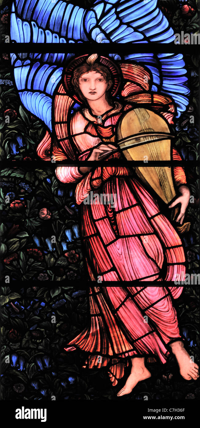 A stained glass window, by Edward Burne-Jones, depicting a winged angel playing a Vielle - Stock Image