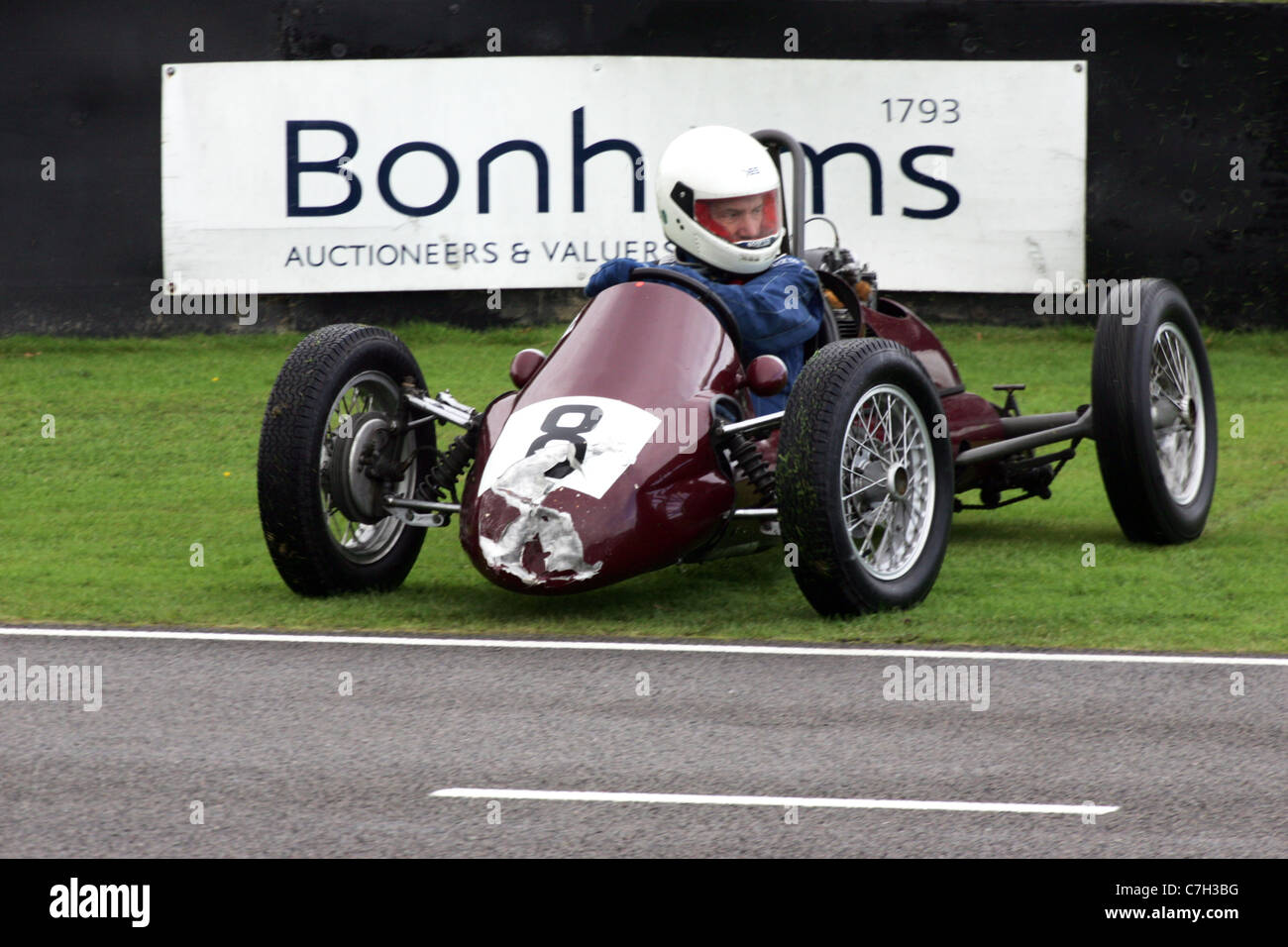 A crashed historic racing car at the Goodwood Revival, West Sussex, UK. - Stock Image