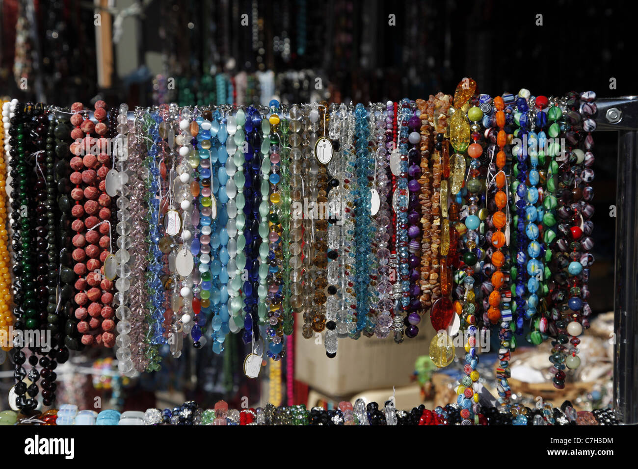 BANGLES BRACELETS NECKLACES SEVASTOPOL CRIMEA UKRAINE 02 September 2011 - Stock Image