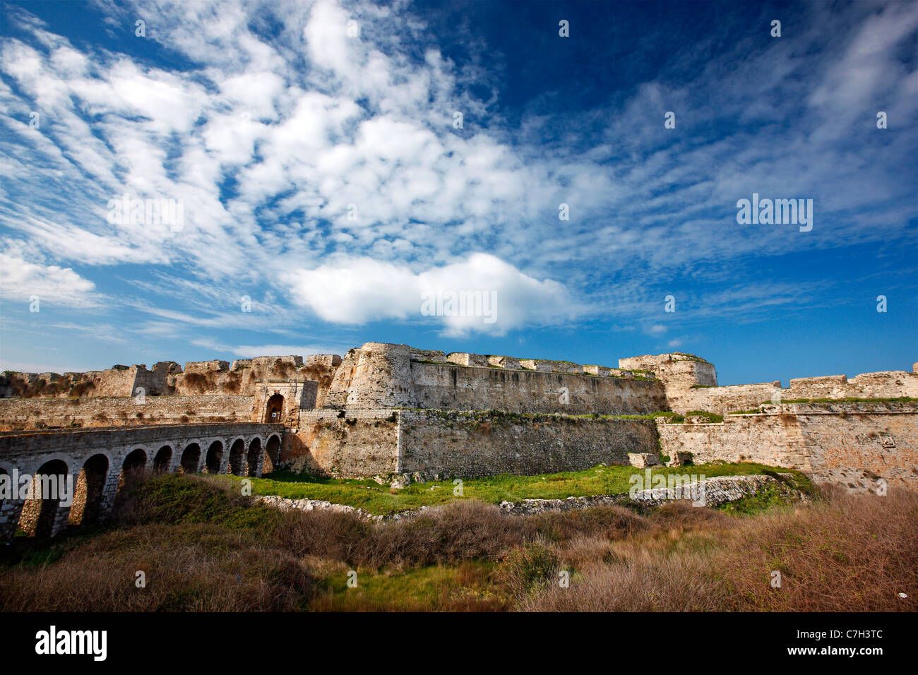 The stone bridge that crosses the ditch and leads to the Venetian castle of Methoni, Messinia, Peloponnese, Greece - Stock Image