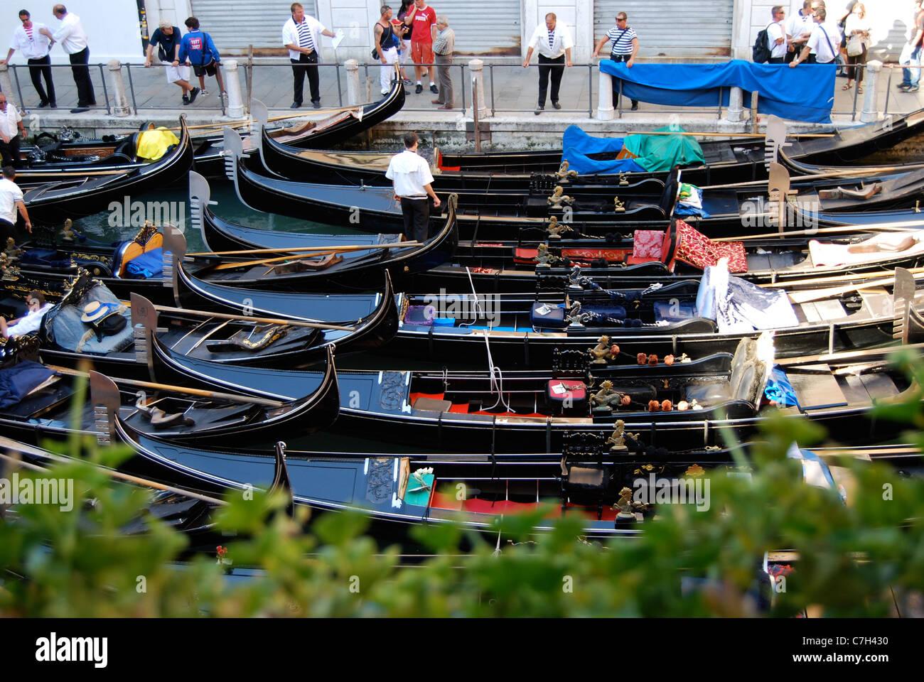 Gondolas moored at Bacino Orseolo at the start of the day - Stock Image