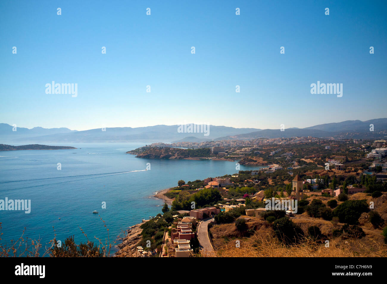 A view looking over the Bay of Mirabello towards Agios Nikolaos on the Greek island of Crete - Stock Image