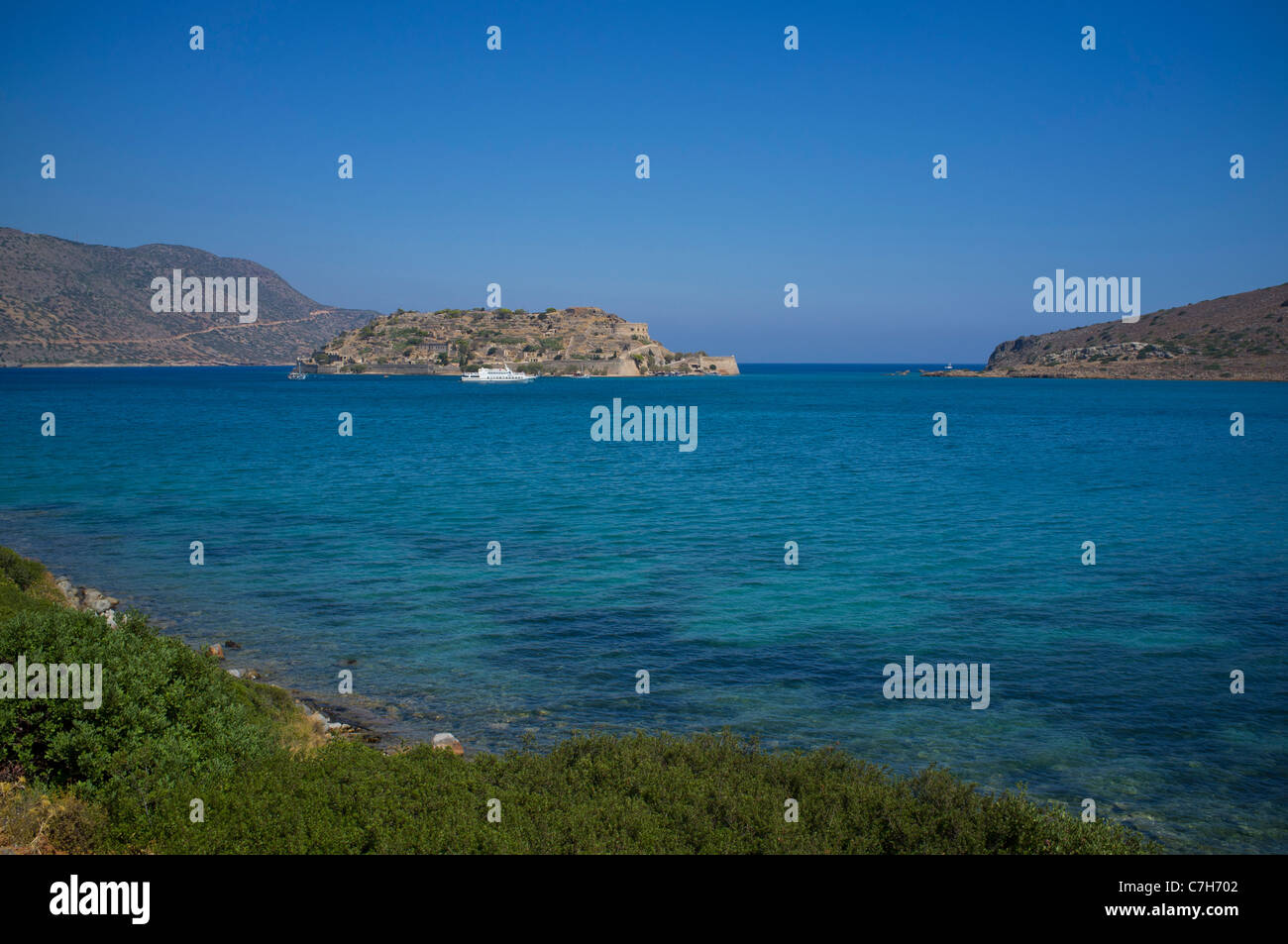 The former leper colony island of Spinalonga on Crete is now a holiday excursion destination for thousand of Holiday - Stock Image