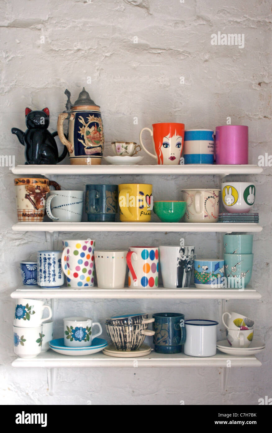 Shelves In The Kitchen Crowded With Mugs Stock Photo Alamy