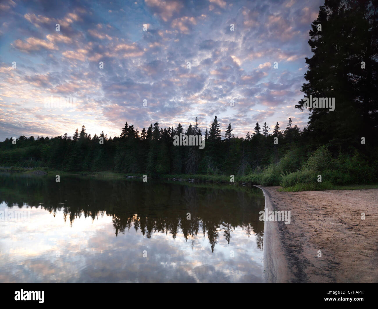 Algonquin Provincial Park summertime nature scenery of the Lake of Two Rivers at sunset. Ontario, Canada. - Stock Image