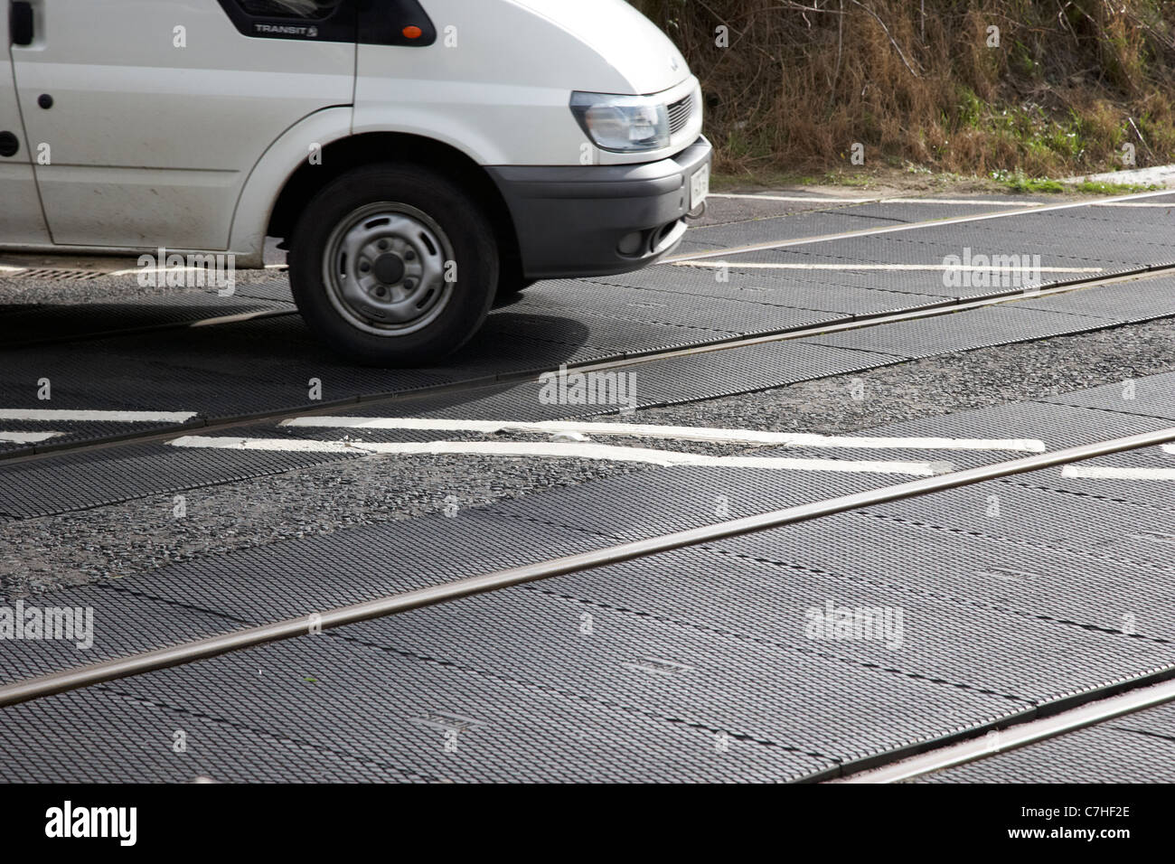 van crossing train tracks on level crossing northern ireland uk - Stock Image