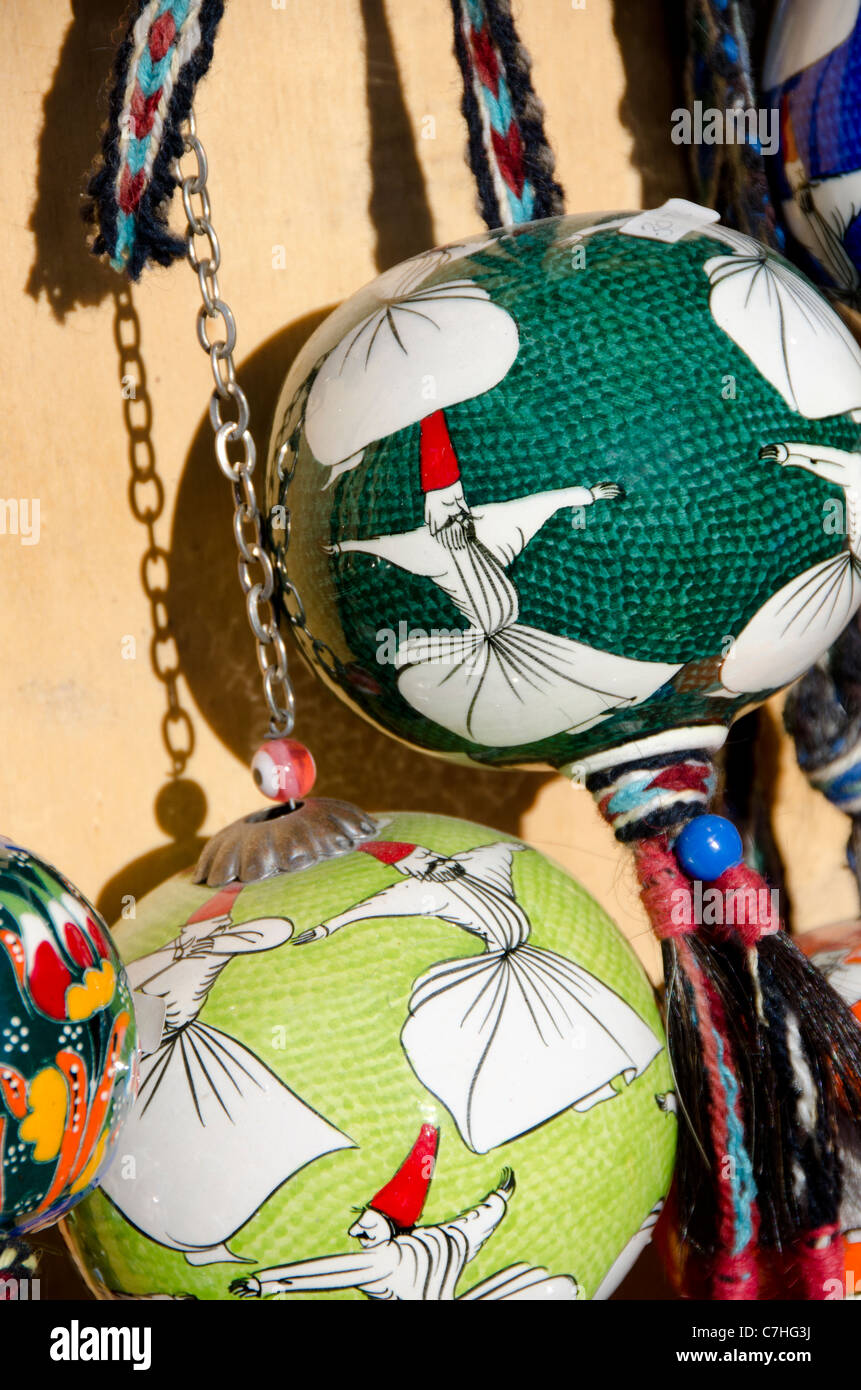 Turkey, Istanbul. Colorful hand painted souvenir pottery globes. - Stock Image