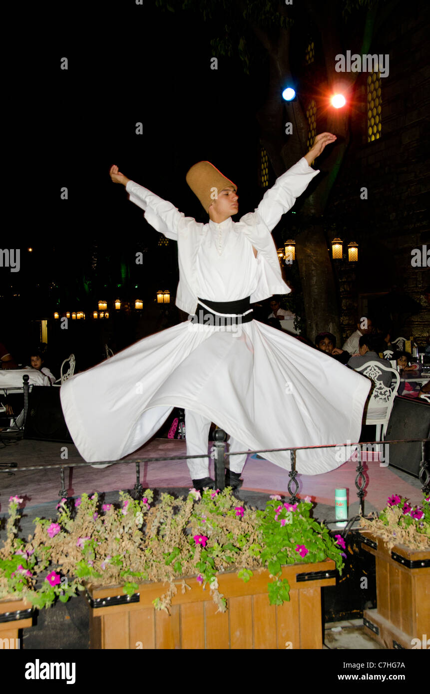 Turkey, Istanbul. Whirling dervish in traditional long robe and hat. - Stock Image