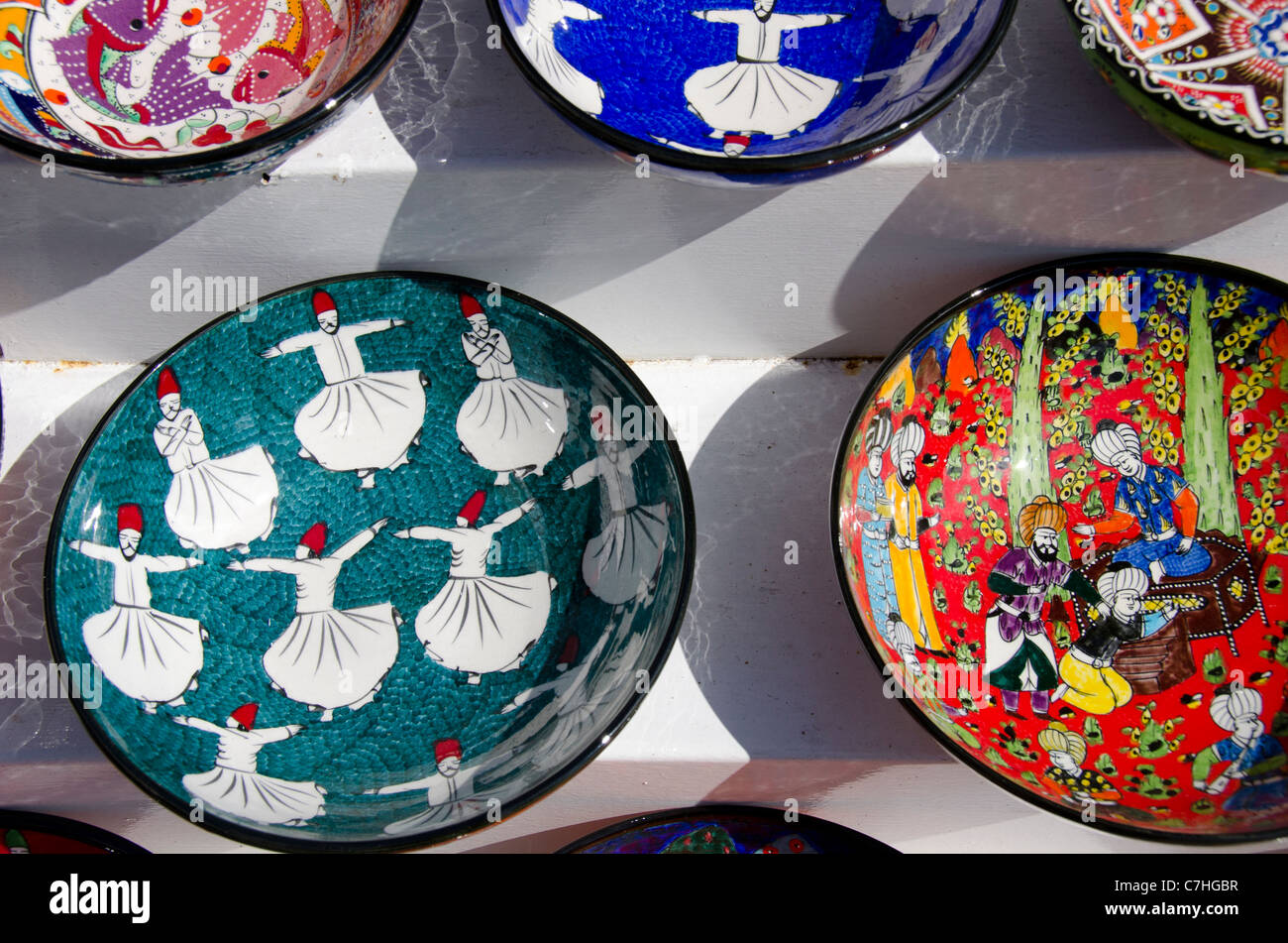 Turkey, Istanbul. Colorful hand painted souvenir pottery, some with whirling dervish design. - Stock Image