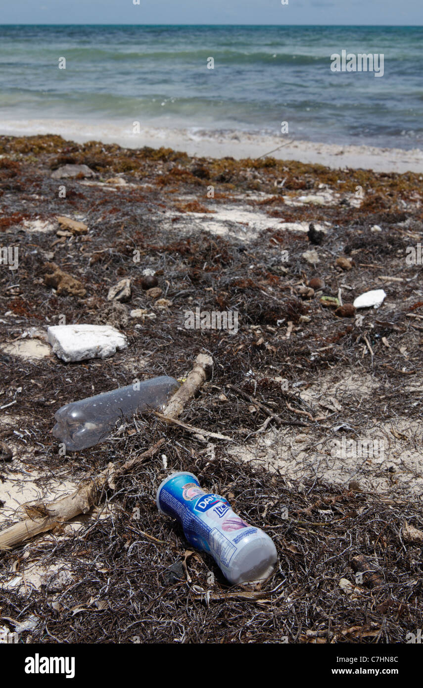 Trash on the shore. Plastic trash washed up on the shore. Puerto Morelos, Caribbean coast of Mexico. - Stock Image
