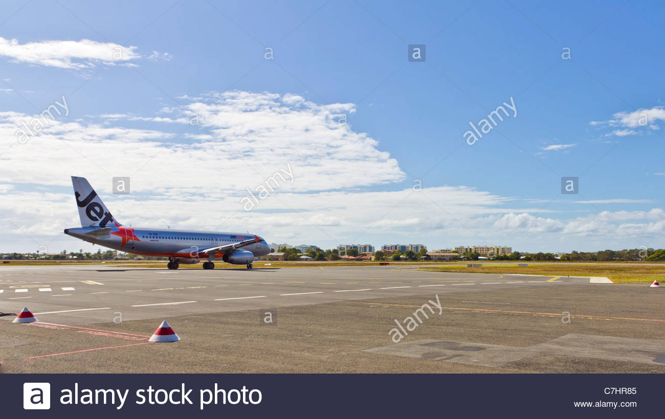 Jetstar airplane taxiing for departure from Sunshine Coast Airport, Queensland Australia - Stock Image