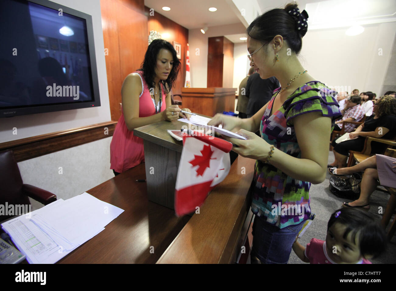 New Canadian citizens attend a citizenship ceremony in Kitchener, Ontario - Stock Image