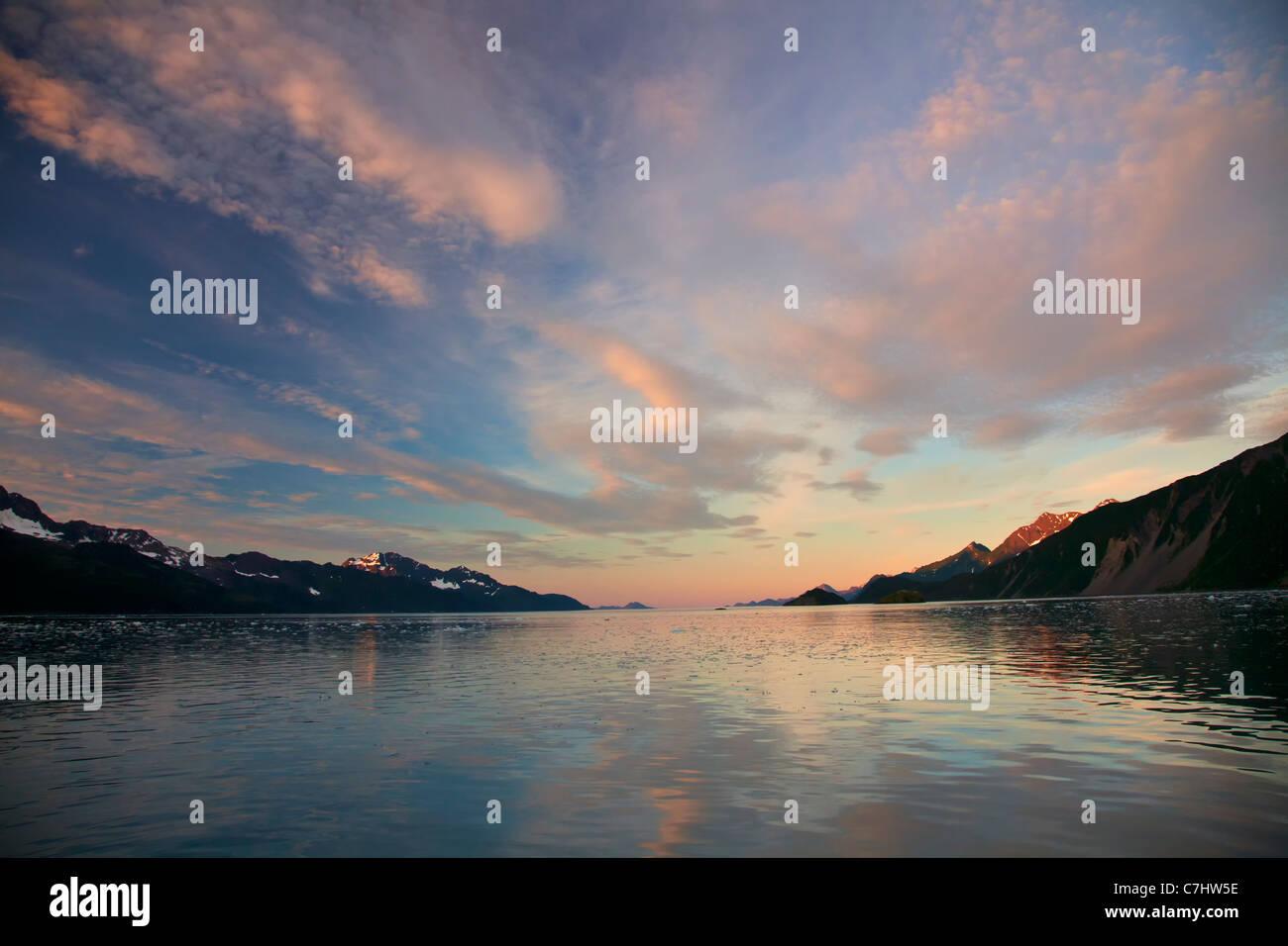 Sunrise on Aialik Glacier and Aialik Bay, Kenai Fjords National Park, near Seward, Alaska. - Stock Image