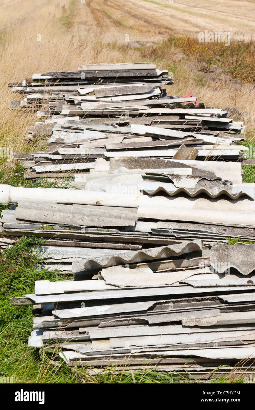 Asbestos illegally dumped on famrland near Banks, Southport, Lancashire, UK. - Stock Image