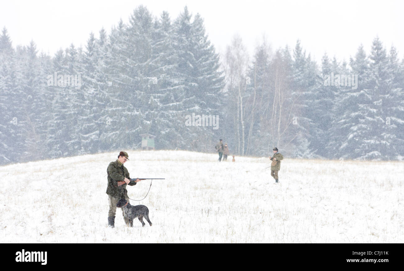 hunter with his dog hunting - Stock Image