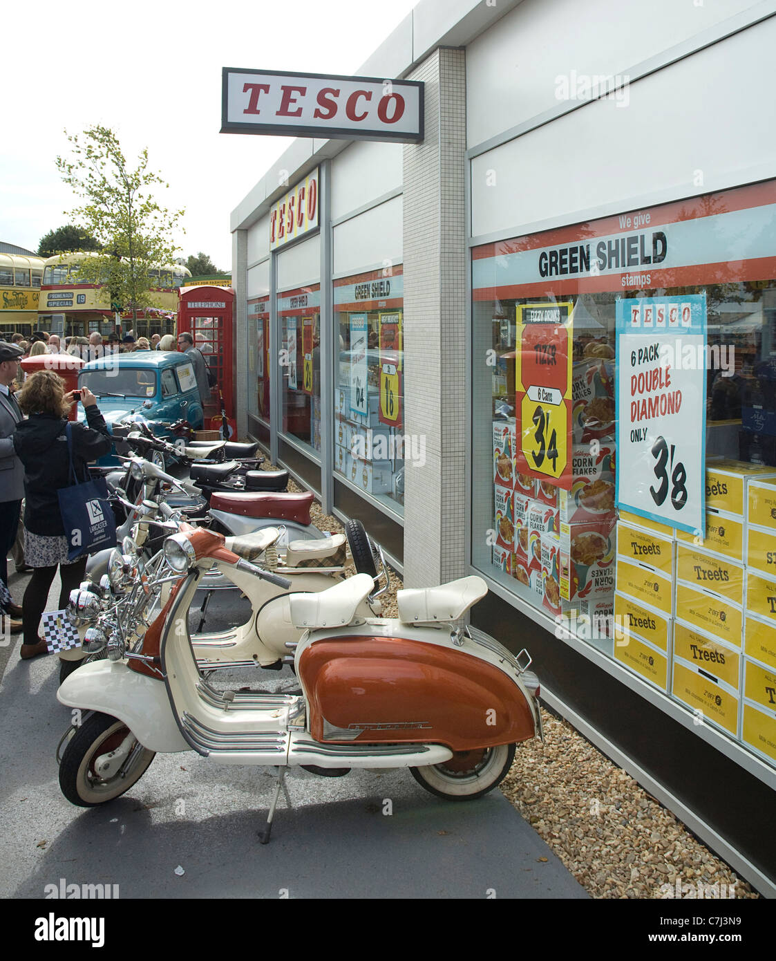 Tesco retro supermarket with scooters at 2011 Goodwood Revival - Stock Image