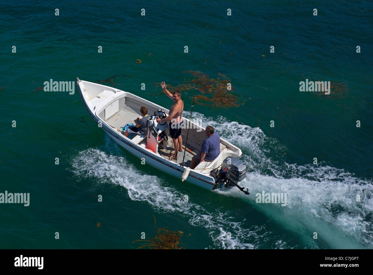Men setting out to go fishing in Jersey, Channel Islands - Stock Image