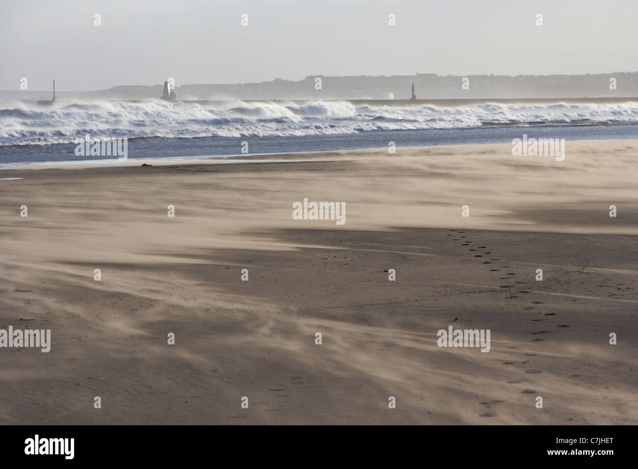 wind blowing sand over castlerock beach county derry londonderry northern ireland uk - Stock Image