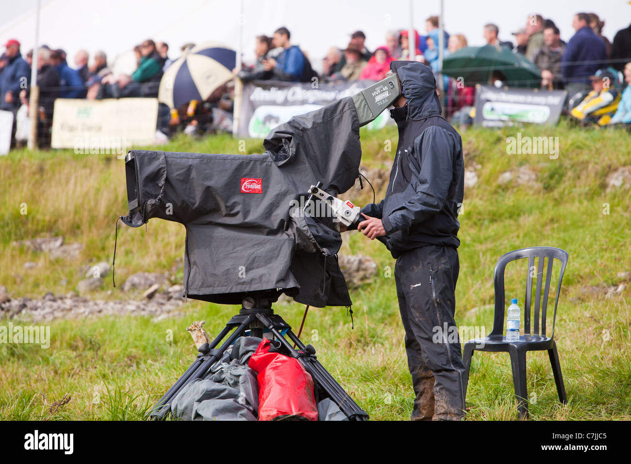 A man filming at the World Sheep Dog Trials at Lowther, Penrith, cumbria, UK. Stock Photo