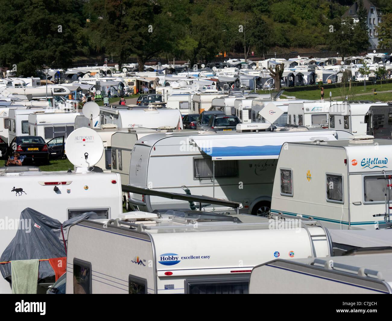 Busy caravan park beside River Rhine at the famous Loreley rock near Saint Goar in Germany - Stock Image