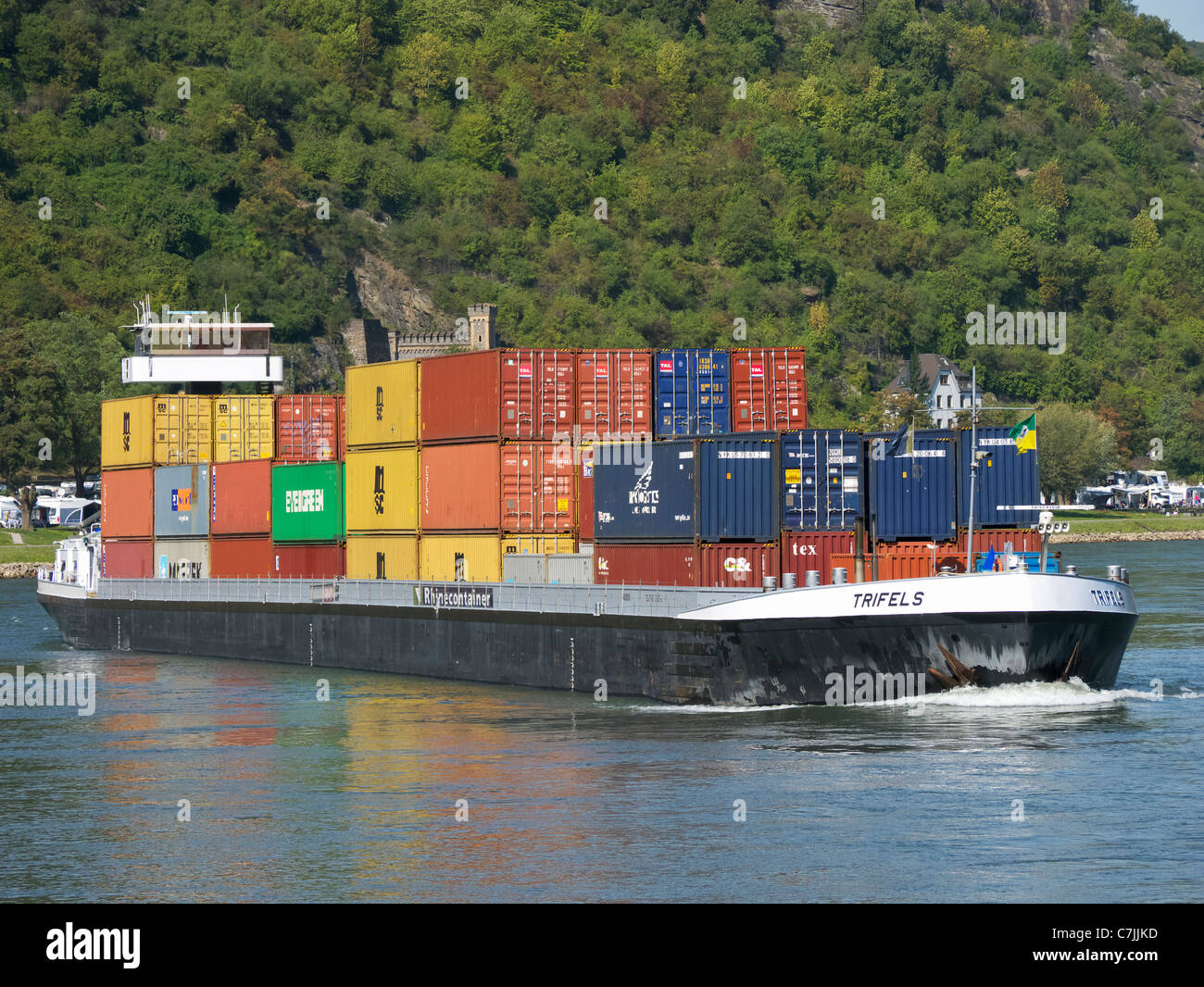 Large barge carrying container freight sailing up the River Rhine in Germany - Stock Image