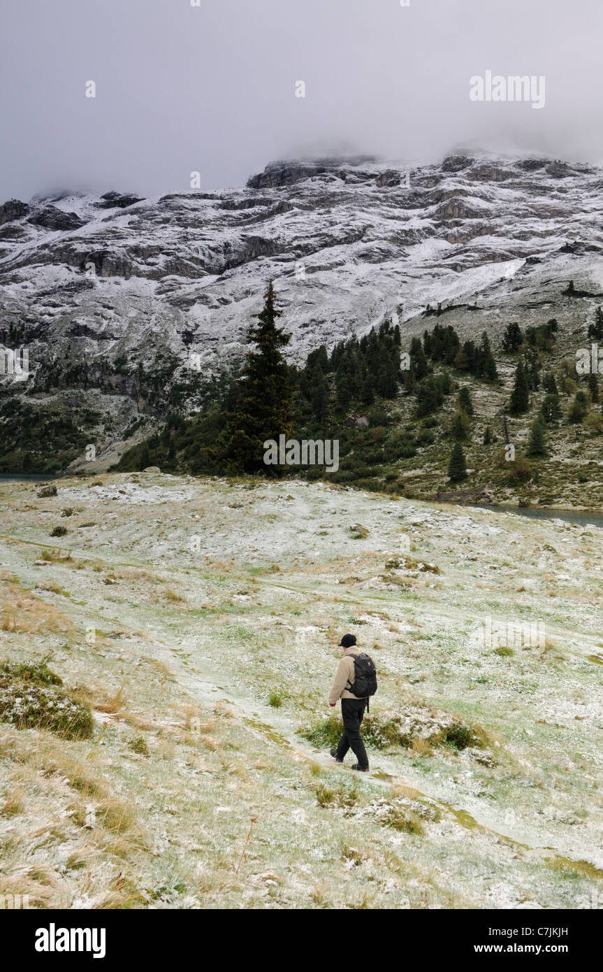 Switzerland, Berner Oberland. Hiker on the Engstlenalp. - Stock Image