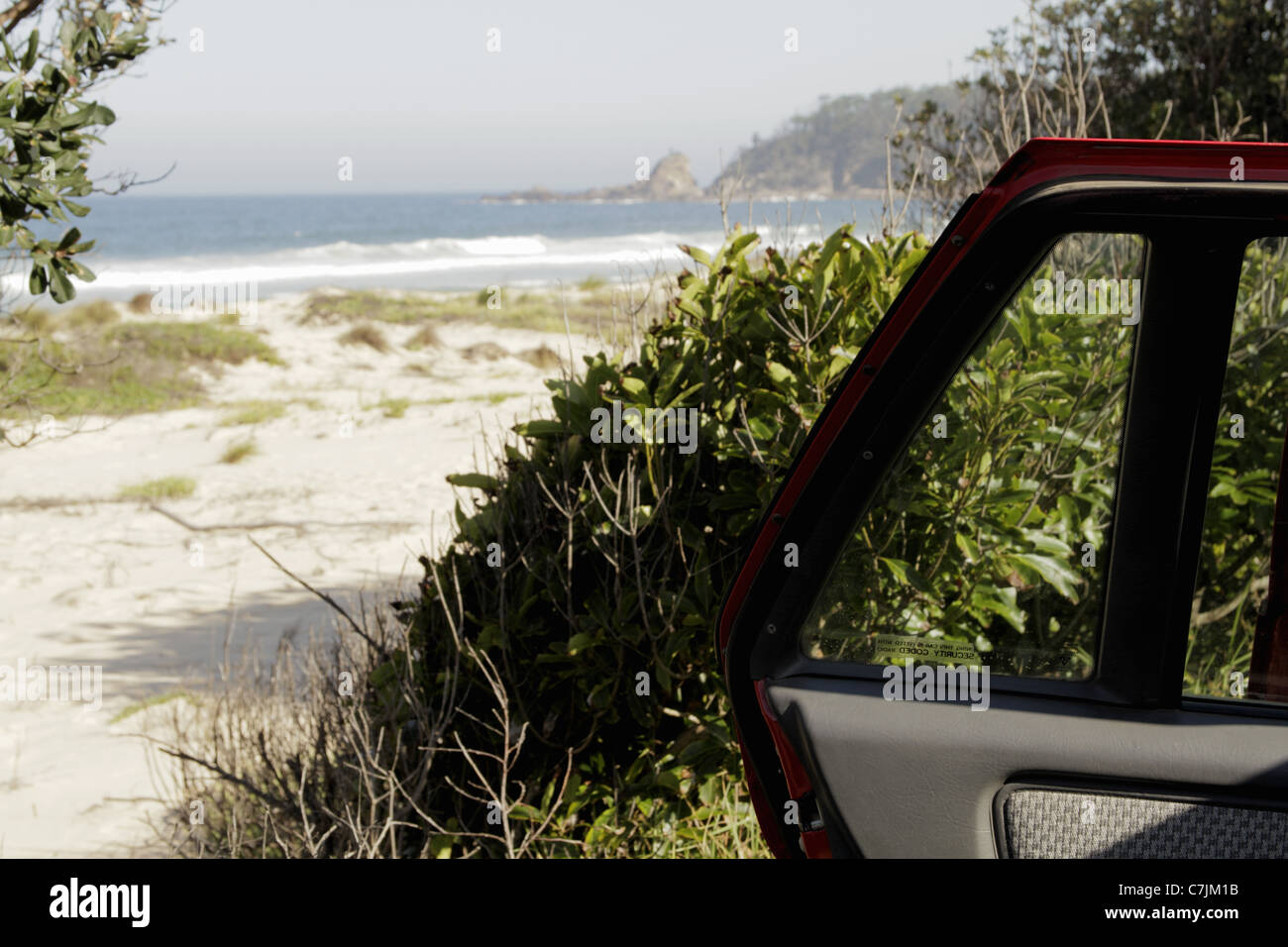 Open car door parked near beach - Stock Image