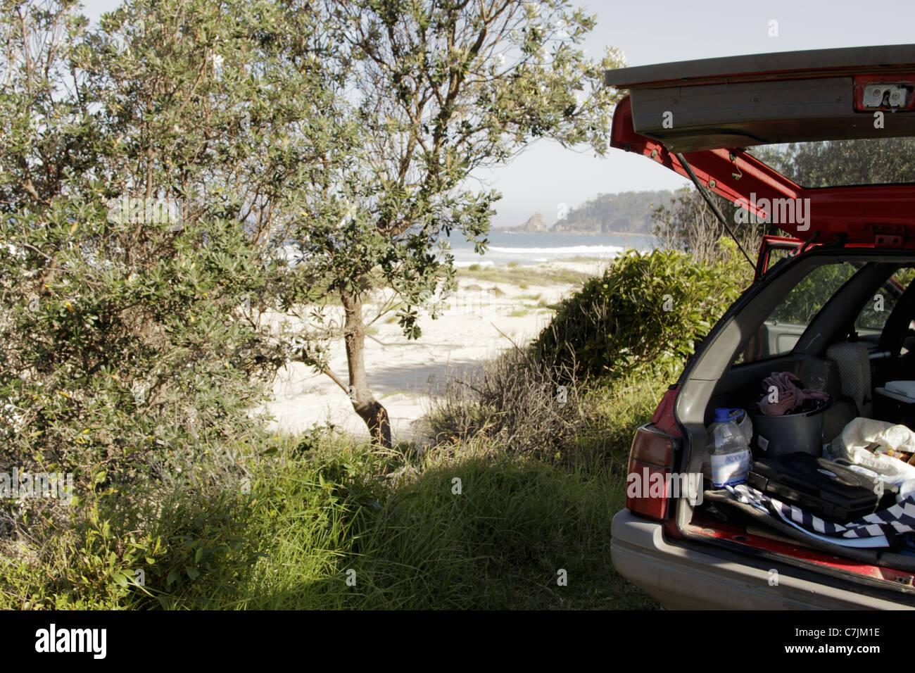 Open car trunk parked near beach Stock Photo