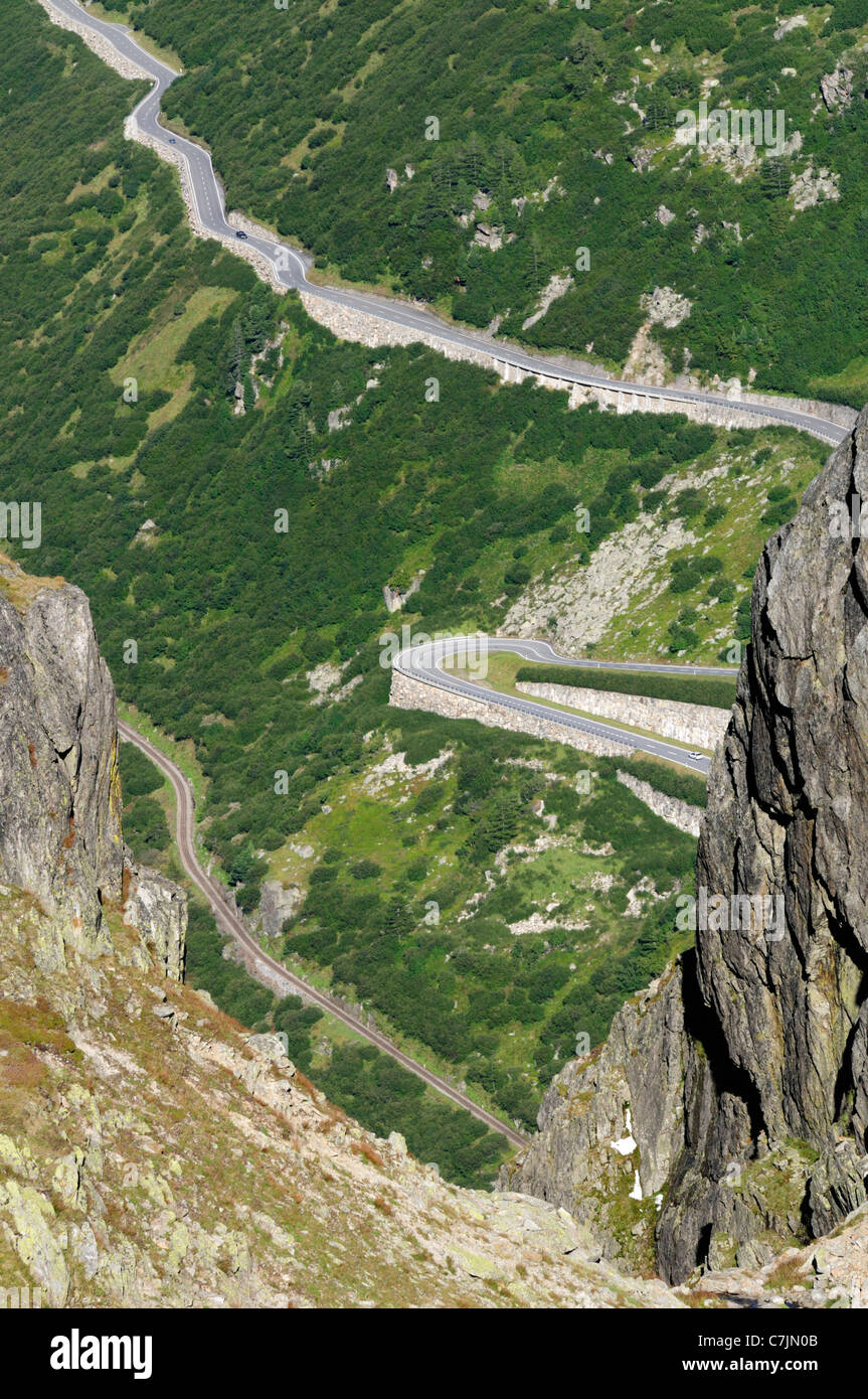 Switzerland, Furkapass nr. Gletsch. South-western ascent of the Furka mountain road and Furka steam railway track - Stock Image