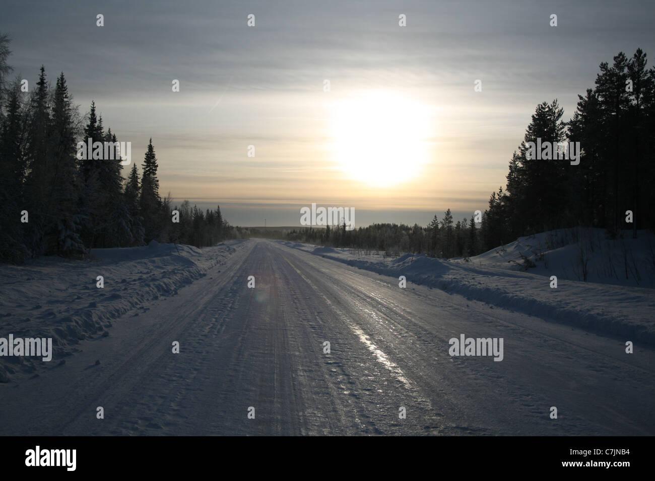 Frozen road in Northern Sweden - Stock Image