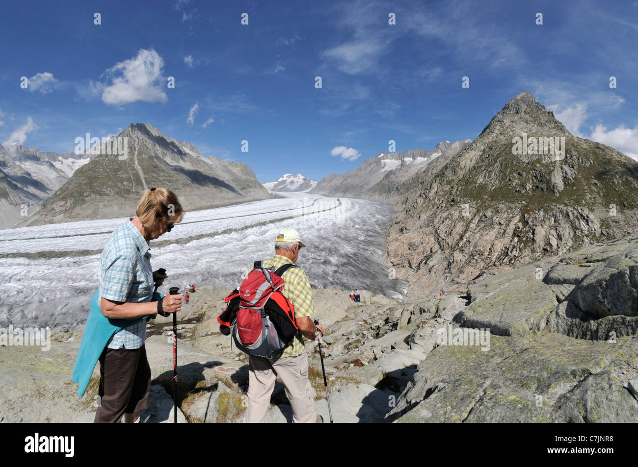 Switzerland, Valais, Western Europe, Aletsch Glacier (UNESCO world heritage site). Hikers on the panorama trail. - Stock Image