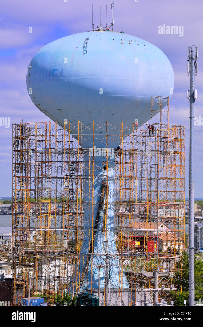Scaffolding surrounds the water tower on 14th St. in Brigantine Beach in preparation for repainting - Stock Image