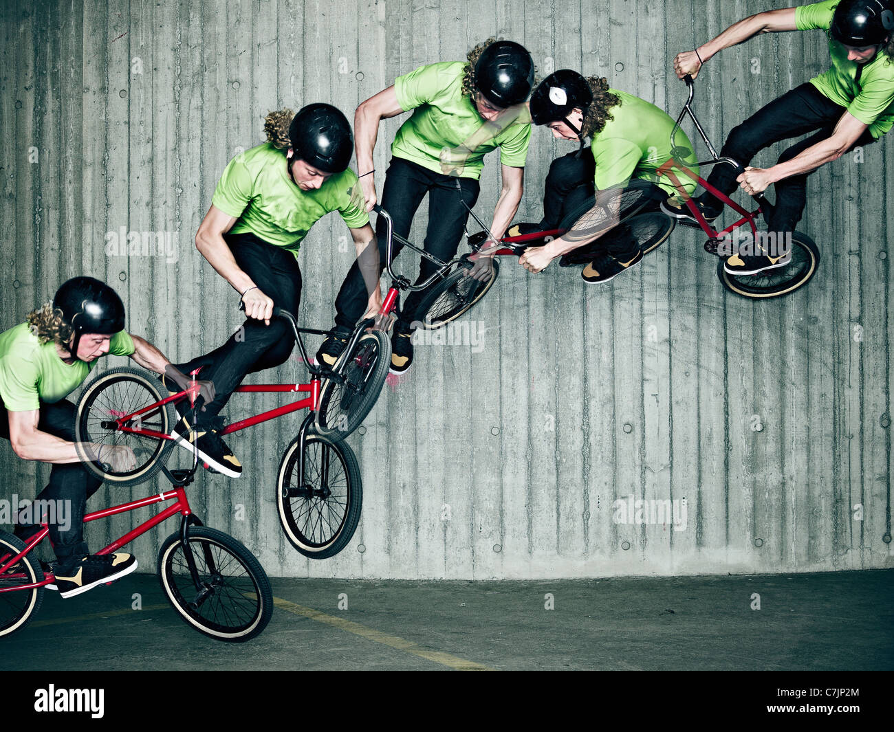 Multiple exposure of man doing bmx trick - Stock Image