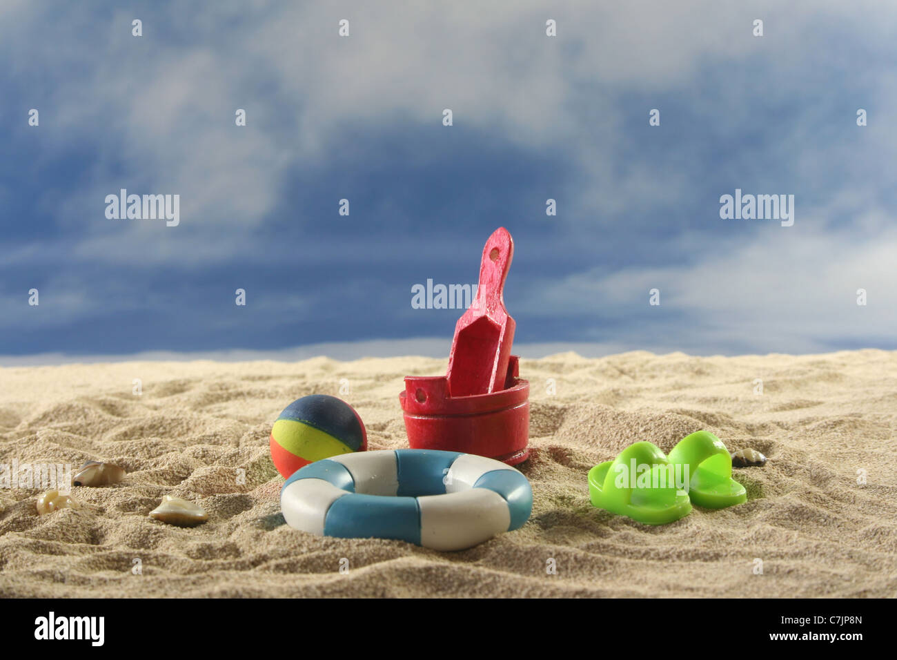 Toy with water polo and swimming ring on the beach Stock Photo