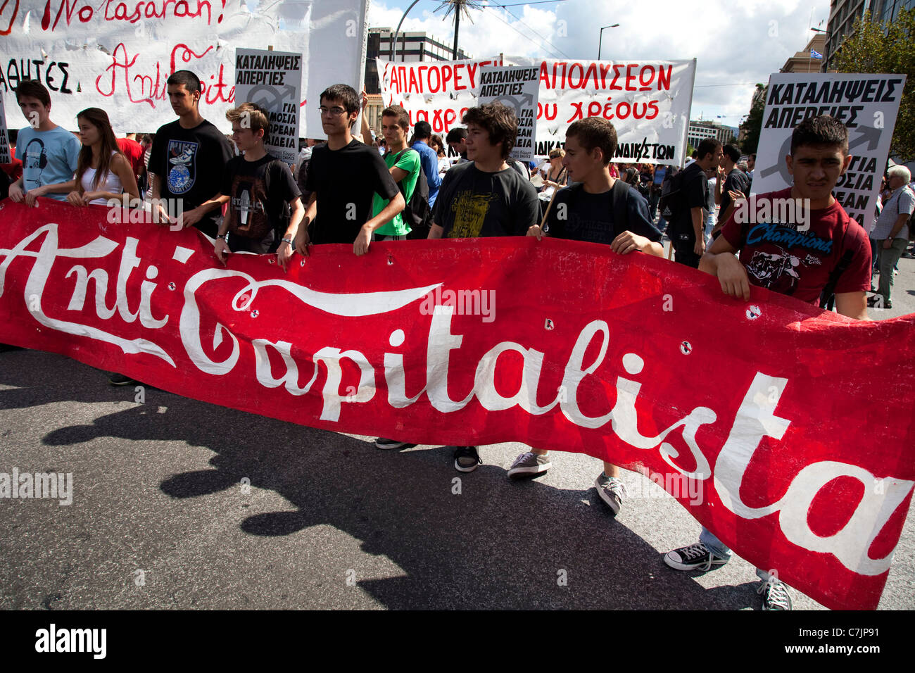 Students march with anti capitalist banner in demonstration against austerity measures and planned education reforms - Stock Image
