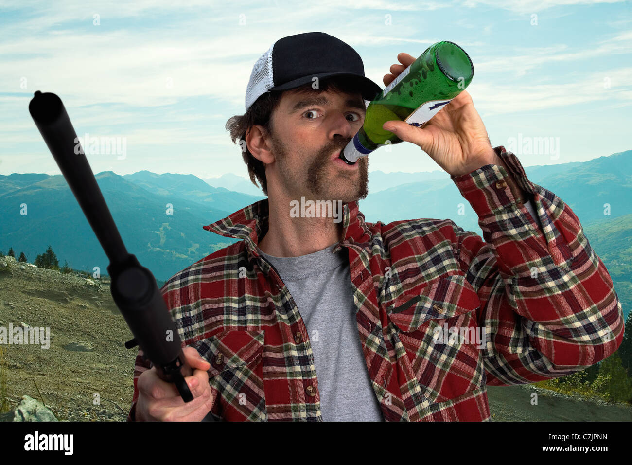 Man with automatic gun drinking beer - Stock Image