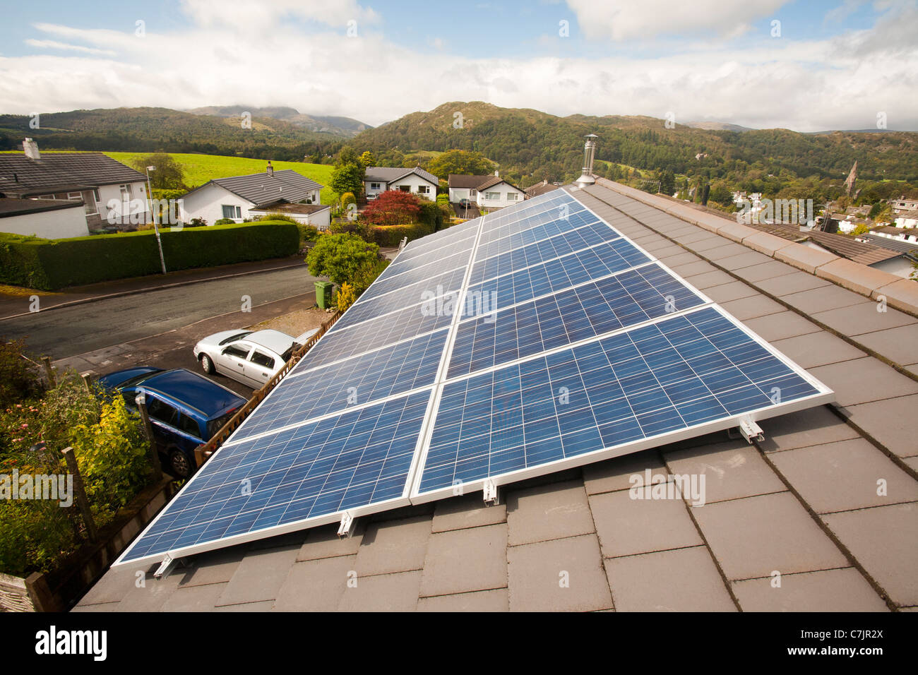 Solar voltaic panels on a house roof in Ambleside, Cumbria, UK. - Stock Image
