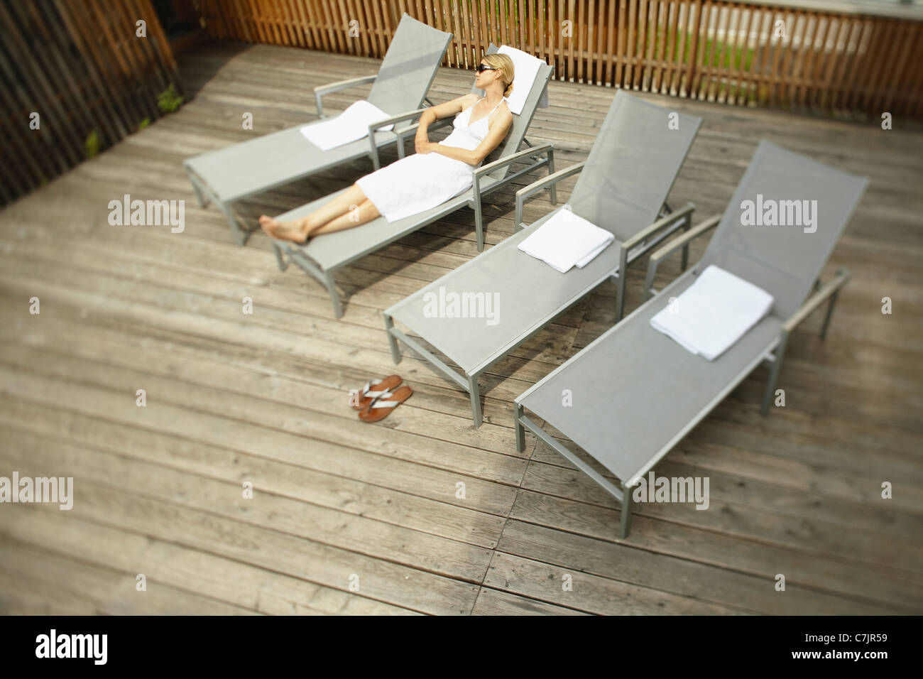 Woman Sunbathing In Lawn Chair