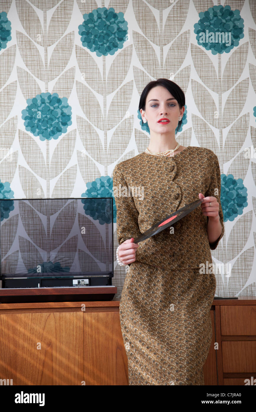 Woman in vintage dress with vinyl record Stock Photo