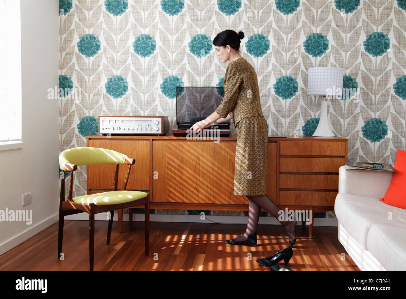 Woman in vintage dress playing records Stock Photo