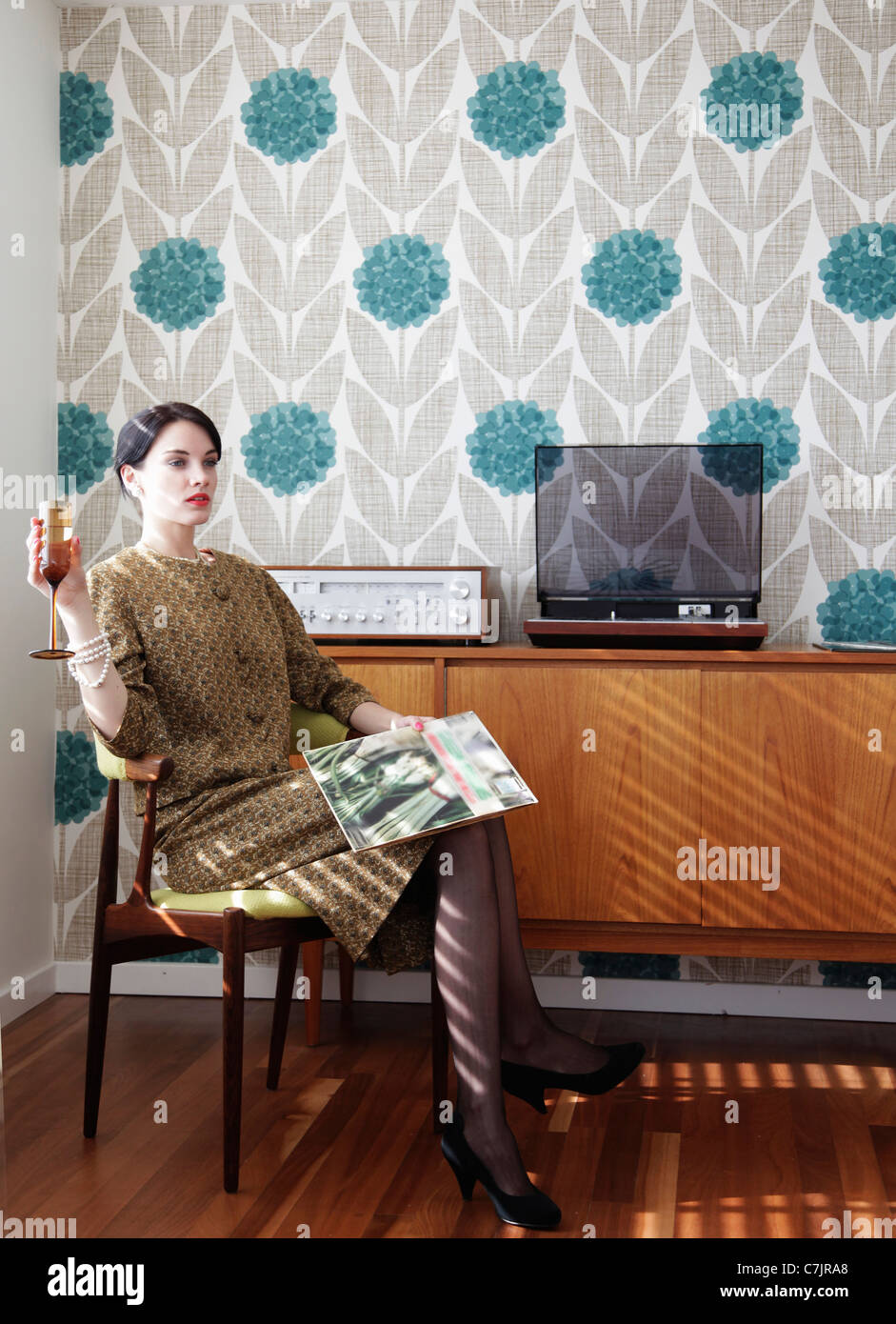 Woman in vintage dress with record Stock Photo
