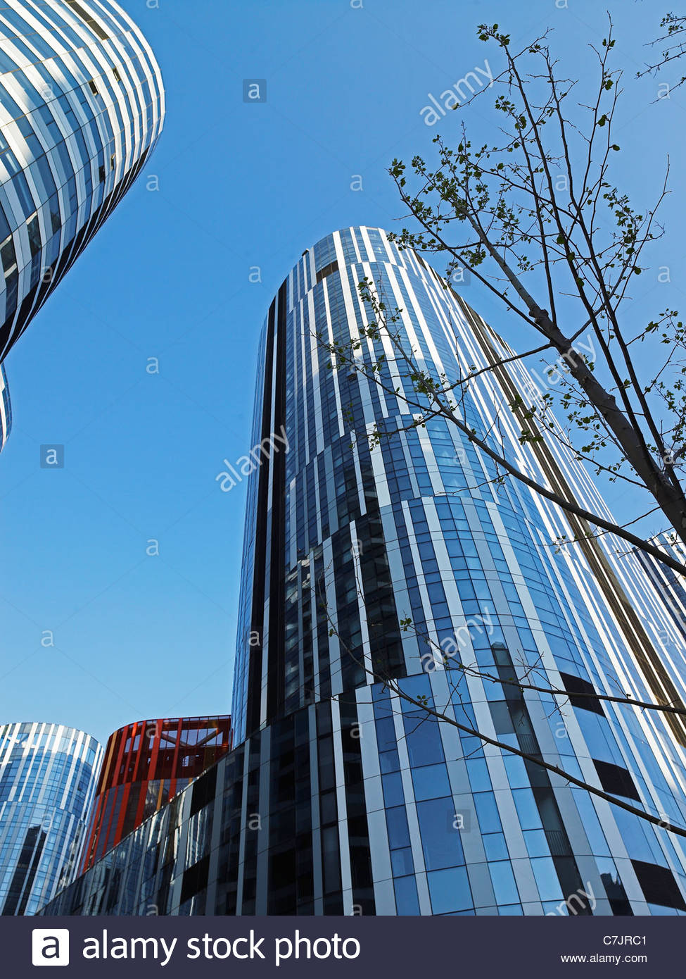 Modern skyscrapers against blue sky - Stock Image