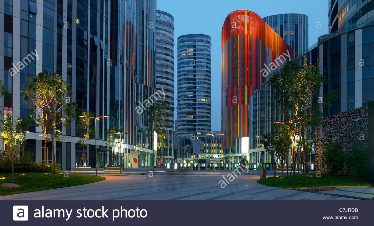 Modern skyscrapers on city street - Stock Image