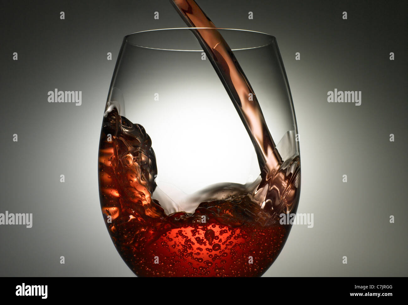 Close up of wine pouring into glass - Stock Image