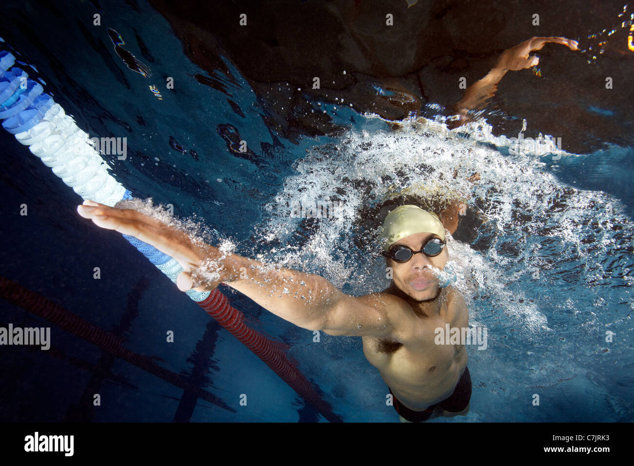 Swimmer doing front crawl in pool - Stock Image